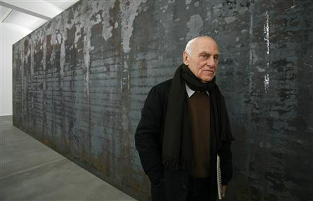 Artist Richard Serra poses for photographers beside one of his works entitled 'Fernando Pessoa' during the unveiling of his new exhibition at the Gagosian Gallery in London